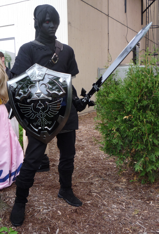 A dark Link cosplayer holding a sword and shield at ACen 2010