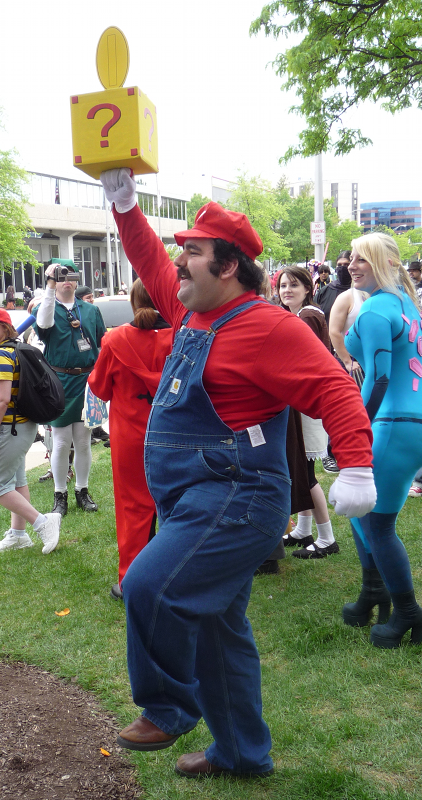 A Mario cosplayer at ACen 2010 hitting a question block and getting a coin