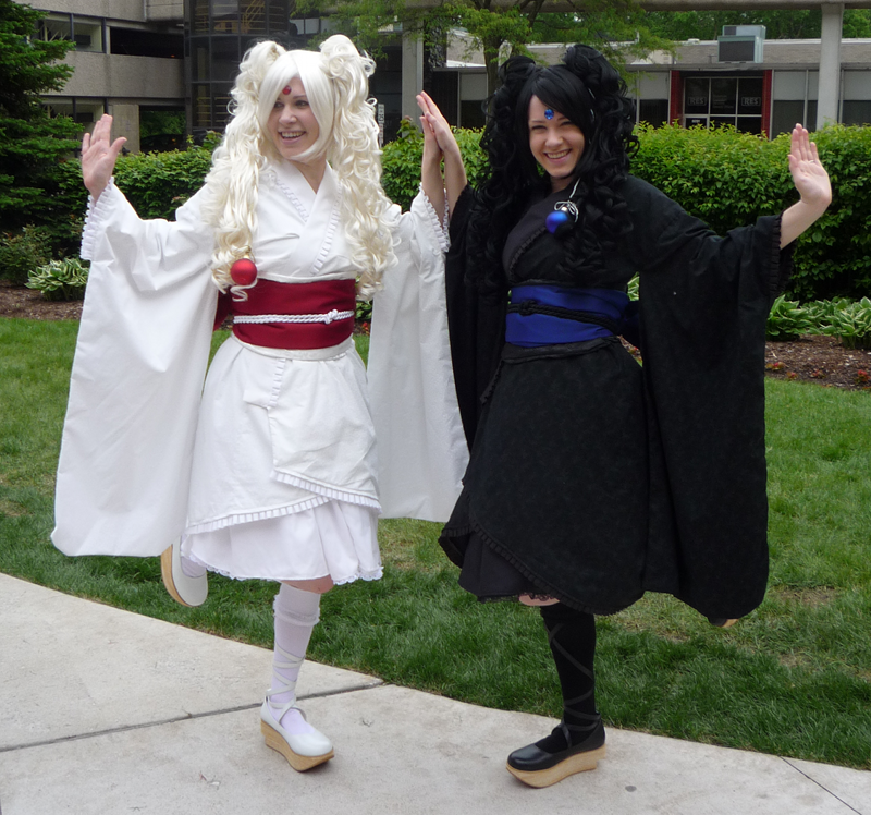 Two girls cosplaying as the white and black Mokonas from Tsubasa Chronicles and XXXHolic at ACen 2010