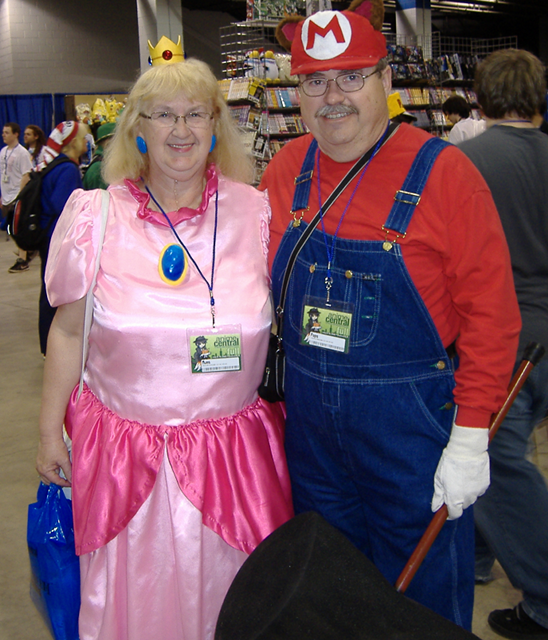 A couple dressed as Mario and the Princess