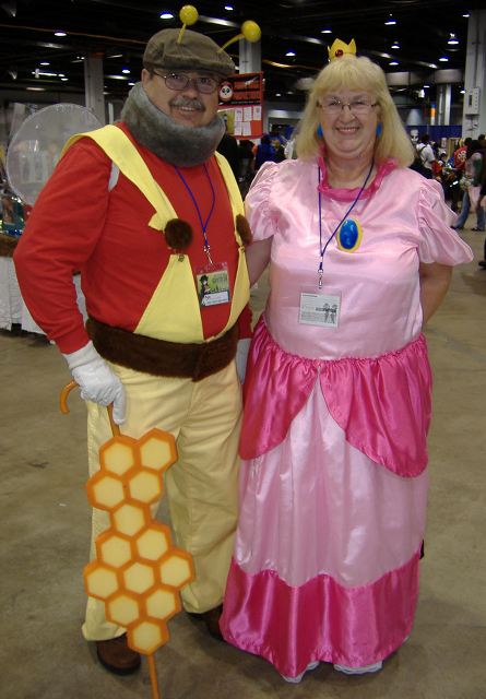 A couple cosplaying as Bee-suit Mario and the Princess