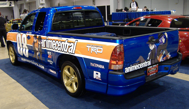 A pickup truck with an Acen paint job